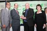 R-L: SFDA's Jackie Zelman and James Osteen, Jr. receive the award from Ricardo Panez and Ralph MacNamara, GMCC's Technology & Bioscience Committee