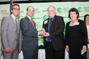 R-L: SFDA's Jackie Zelman and James Osteen, Jr. receive the award from Ricardo Panez and Ralph MacNamara, GMCC's Technology & Bioscience Committee