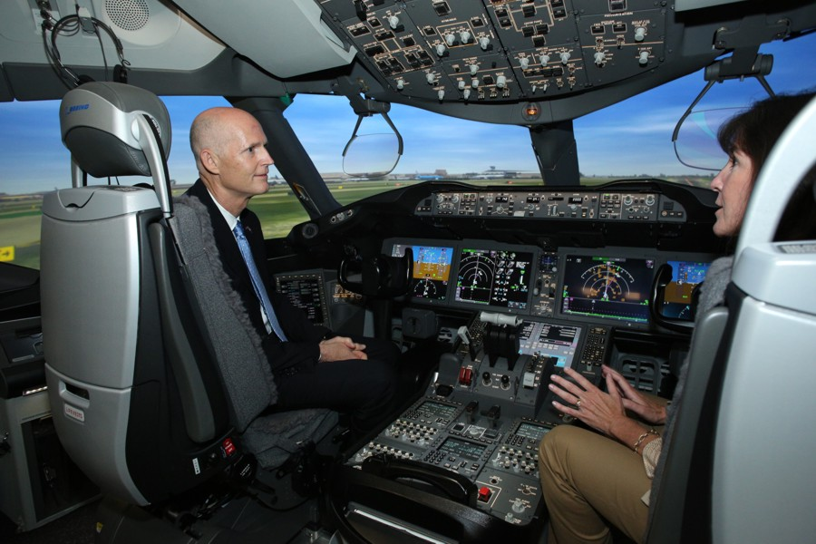 Florida Governor Rick Scott (left) and Sherry Carbary, vice president, Boeing Flight Services inside the 787 simulator at the Miami campus